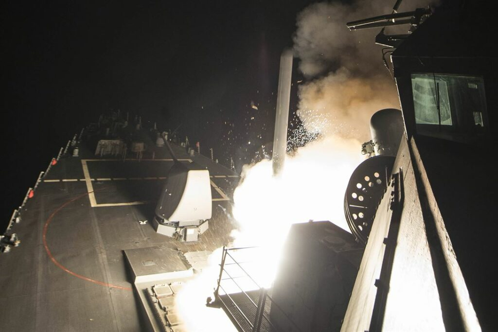 The Arleigh Burke-class guided-missile destroyer USS Ross fires a tomahawk land attack missile from the Mediterranean Sea at Syria, April 7, 2017. (Navy photo by Petty Officer 3rd Class Robert S. Price)