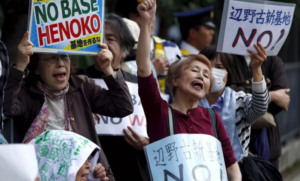 People protest the planned relocation of a US military base in Japan to Okinawa's Henoko coast on April 17, 2015. (Reuters / Issei Kato)