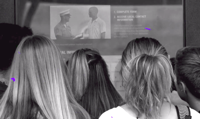Students are encouraged to upload personal information to military recruiters, possibly circumventing federal law. The screen shows a recruiter and a young man and instructs students to complete the form.