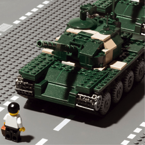 A Lego sculpture of a lone protestor facing a tank