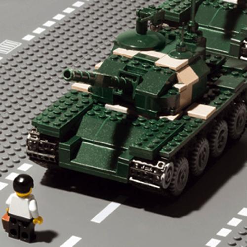 A Lego sculpture of a lone protestor facing a tank