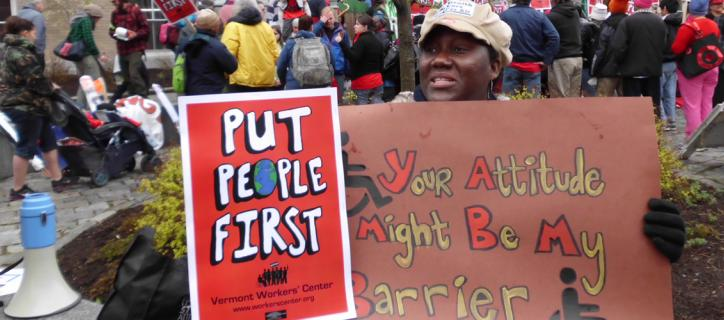 "Protest sign: ""Put People First"""