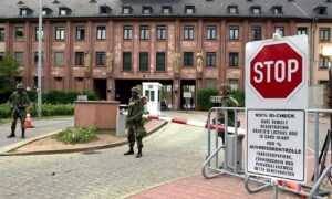 Different times ... US soldiers stand guard at the entrance of the US Campbell Barracks in Heidelberg in 2002.