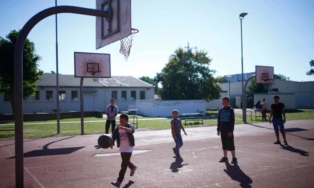 Children play basketball at Patrick Henry Village refugee centre in 2015.