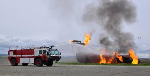 A Beale fire truck sprays down a simulated aircraft fire - Beale Air Force Base