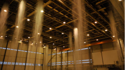 Poisonous foam fills the hangar at Ramstein Air Base, Germany during a biennial fire suppression system test, Feb. 19, 2015 - U.S. Air Force photo.
