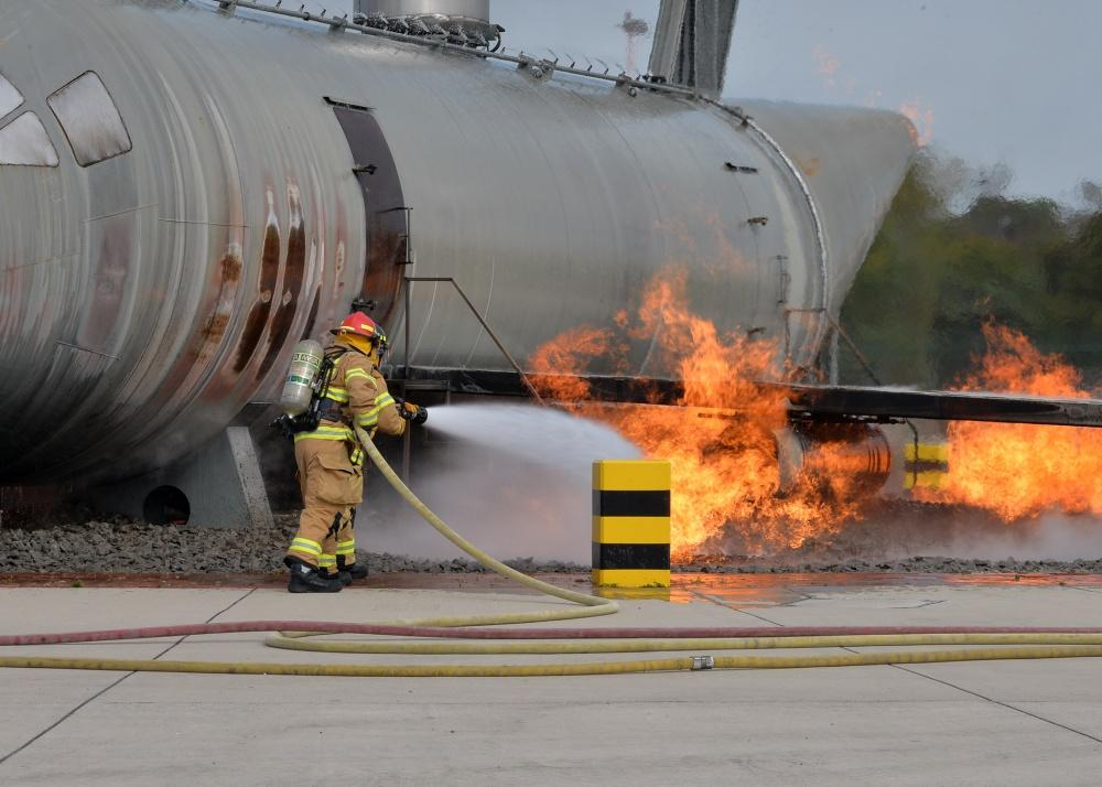 A firefighter practices dousing flames using carcinogenic foam at Ramstein Airbase, Germany October 6, 2018. - U.S. Air Force photo.