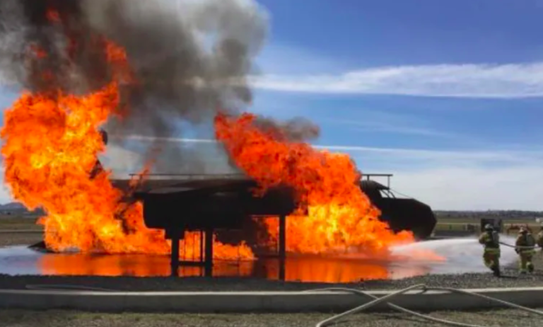 Fire fighters at March Air Reserve Base in Riverside County practice dousing a petroleum fire using carcinogenic foam.