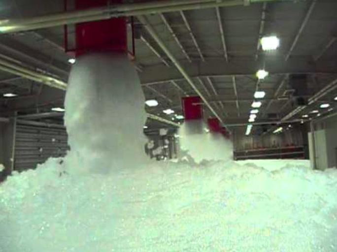 Ellsworth Air Force Base in South Dakota tests out its aqueous film-forming foam sprinkler system in an airport hangar.