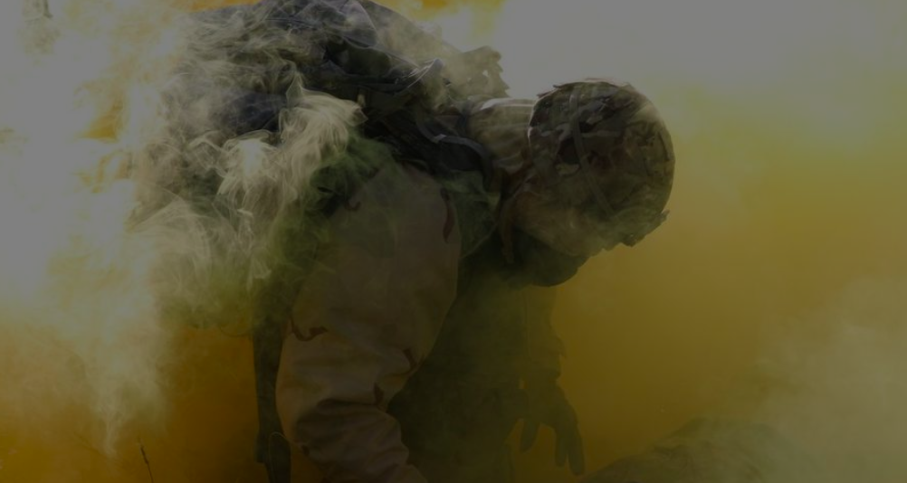 A soldier in a cloud of war