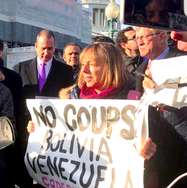 Medea Benjamin protesting coups in Bolivia and Venezuela