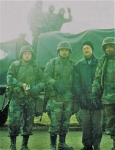 "Pat Elder with U.S. troops in Croatia in 1996. A soldier in the rear shouts ""USA Number 1!"""