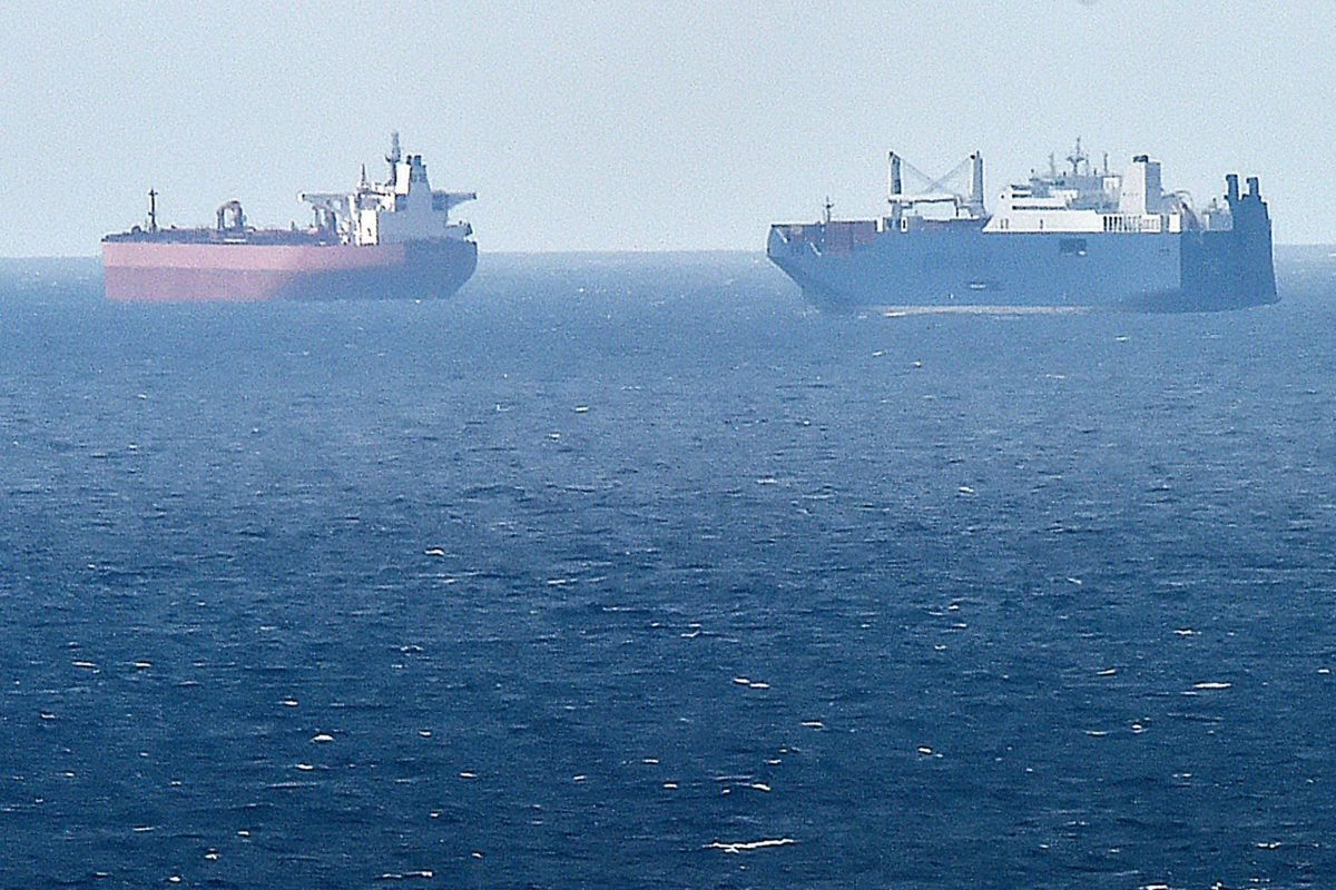 A picture taken on May 9, 2019 from northern port of Le Havre, shows Saudi cargo ship Bahri Yanbu (R) next to British crude oil tanker Nordic Space (L) waiting in the port of Le Havre. - French President defended his country's arms sales to Saudi Arabia and the United Arab Emirates on 9 May 2019