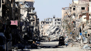 An SDF militant stands amid the ruins of buildings near the Clock Square in Raqqa, Syria October 18, 2017. Erik De Castro | Reuters