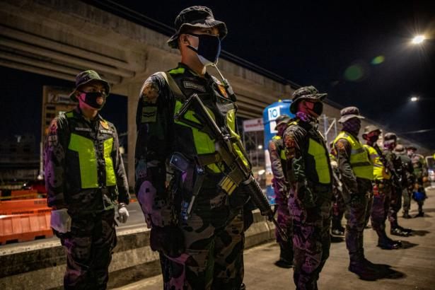 "Policemen stand in formation at a quarantine checkpoint on April 2, 2020 in Marikina, Metro Manila, Philippines. Philippine President Rodrigo Duterte on Wednesday ordered law enforcement to ""shoot"" residents causing ""trouble"" during lockdown in the country."