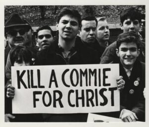 sign reading Kill A Commie For Christ