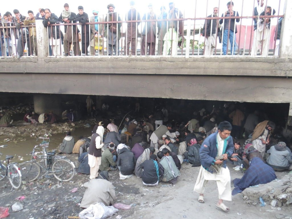 Men gather at the notorious Red Bridge opium den in Kabul.