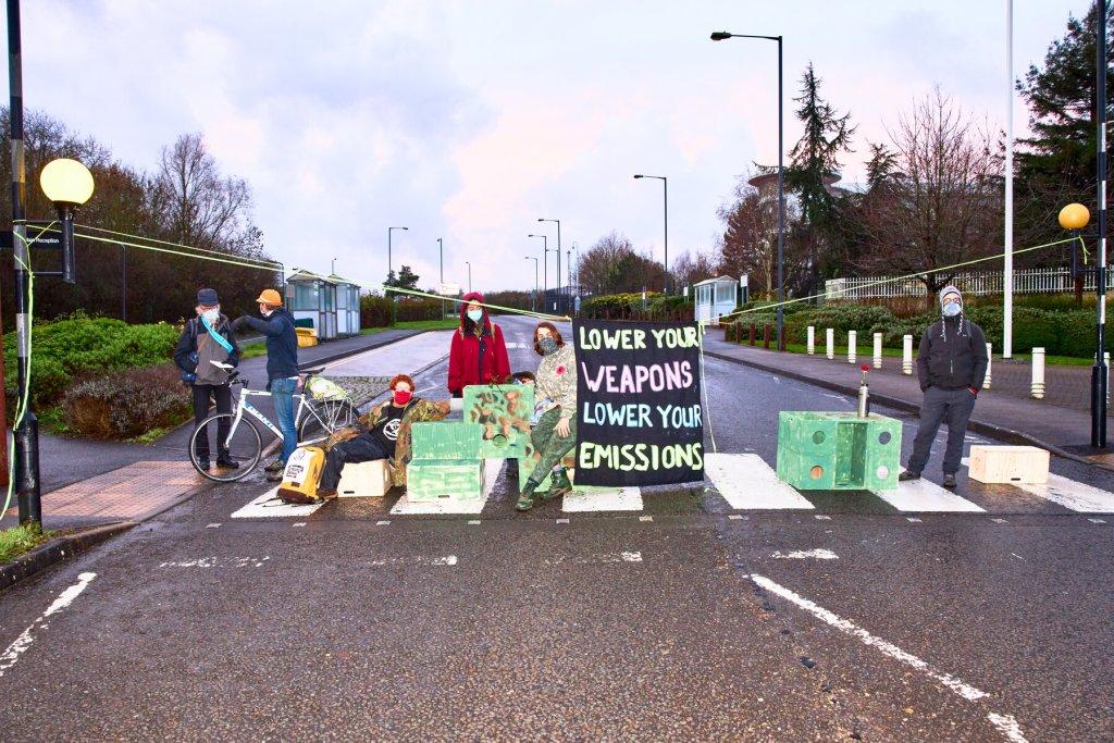 Activists from Extinction Rebellion block roads around the MOD in Filton, Bristol